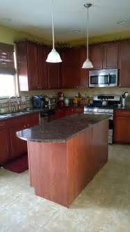 Kitchens With Cherry Cabinets And Wood Floors - what color wood laminate flooring with maple cherry finish cabinets