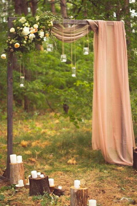 Beautiful simplicity wedding arch with fabric draping