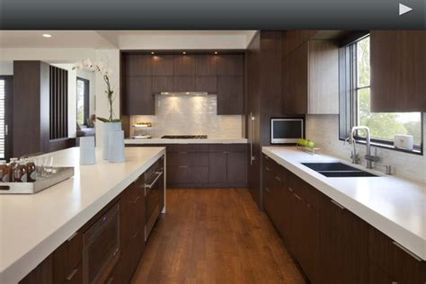 white quartz countertop  dark cabinets modern