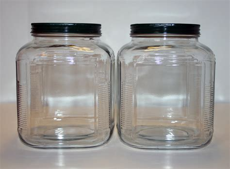 large glass jars matching pair of large glass jars with green metal lids