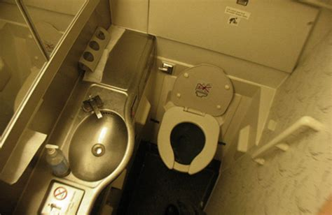 Airplane Bathroom by What Happens When You Flush A Toilet On A Plane