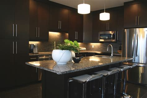 charming Dark Wood Cabinet Kitchens #1: Innovative-backless-bar-stools-in-Contemporary-Toronto-with-Dark-Cabinet-Kitchens-next-to-Natural-Stone-Backsplash-alongside-Stainless-Steel-Appliances-andGranite-Counter-Dark-Wood-Cabinets-.jpg
