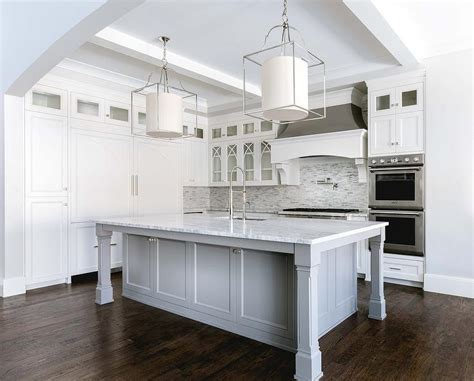 square kitchen island white and silver iridescent tile backsplash transitional
