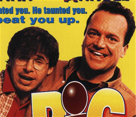 tom arnold beats up barney a close up of rick and tom arnold on the big bully poster