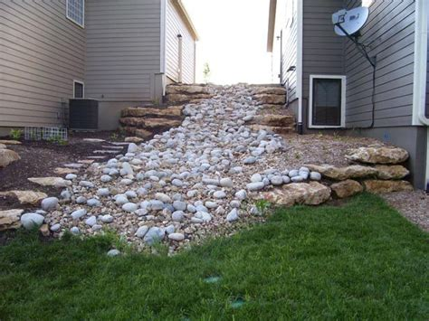 rocks in corner of yard backyard inspiration