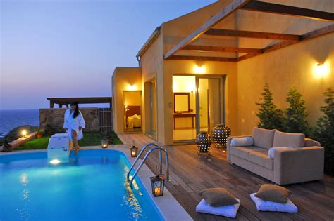 pool in hotel room accommodation of sea side resort spa in agia pelagia thehotel gr