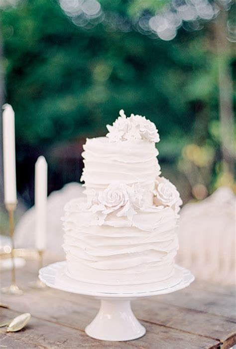 white 2 tier wedding cake two tiered ruffled white wedding cake wedding cakes