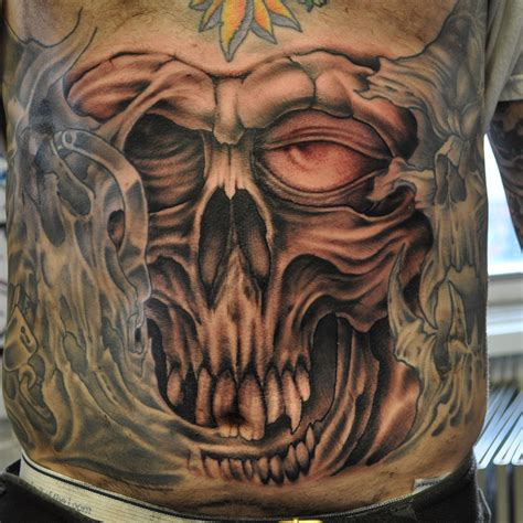 new hope tattoo big skull on a belly by brian ulrich living arts