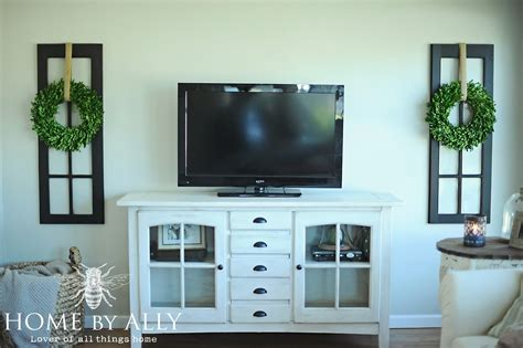 decorating with a tv new windows in the sunroom and decorating around the tv