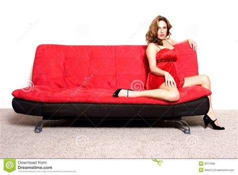 sitting in sofa woman sitting on sofa royalty free stock photos image