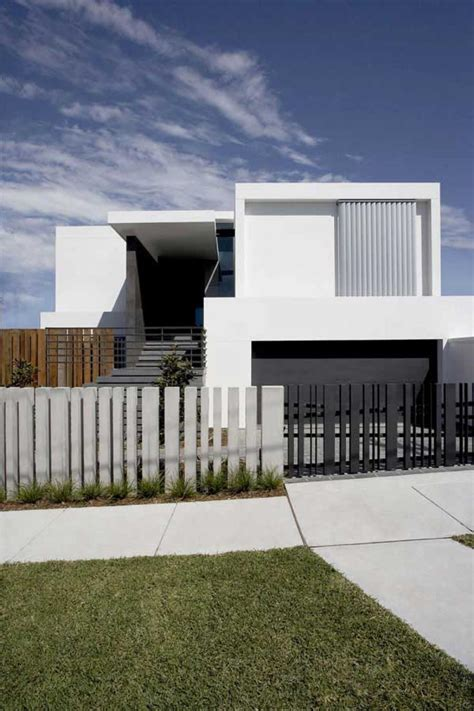 modern house design with front fence black white color