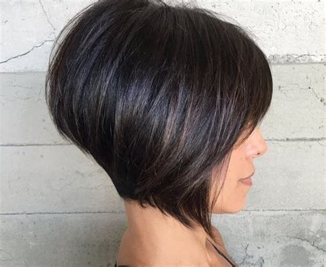 inverted bob hairstyles styling tips women s short brunette inverted bob with bangs and highlights