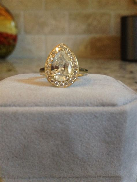 yellow gold engagement ring pear shaped engagement