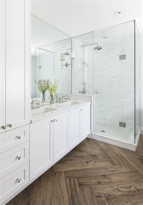 bathrooms with wood tile floors master bathroom with herringbone wood floor marble shower