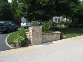 Curb Appeal Landscaping Design - stone veneer driveway entrance garden area with pillar traditional exterior philadelphia