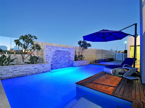 geometric pool design using bluestone with decking decorative lighting pool photo 1187242