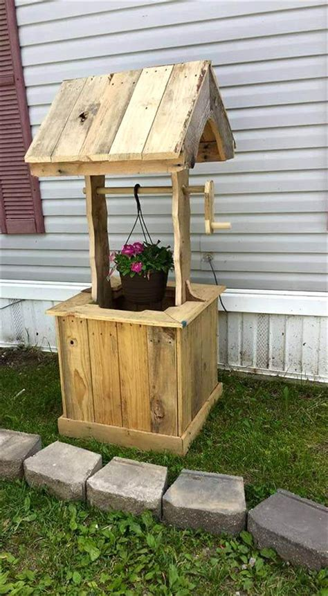 home decor with wood pallets pallet wishing well 70 pallet ideas for home decor