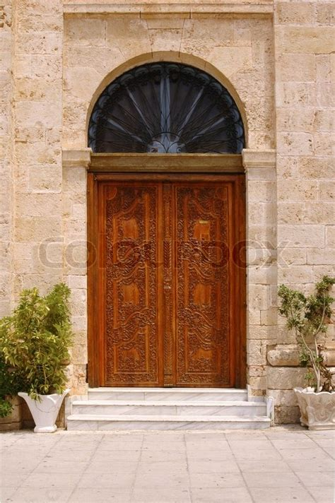 ancient windows and doors ancient wooden door with arched window above stock photo