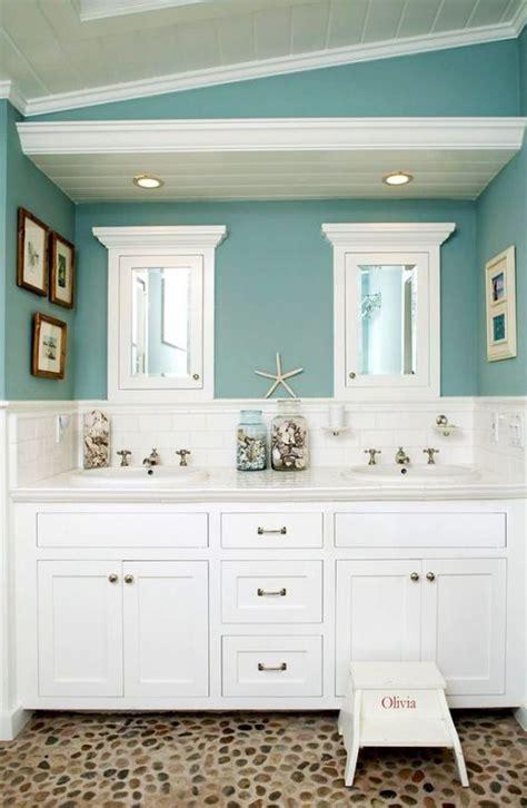 beach theme bathroom love the quot drift wood quot behind the beach themed bathroom cool pinterest blue wall