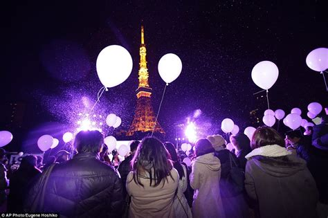 new year midnight temple ceremony new year s balloons in tokyo after sydney s firework