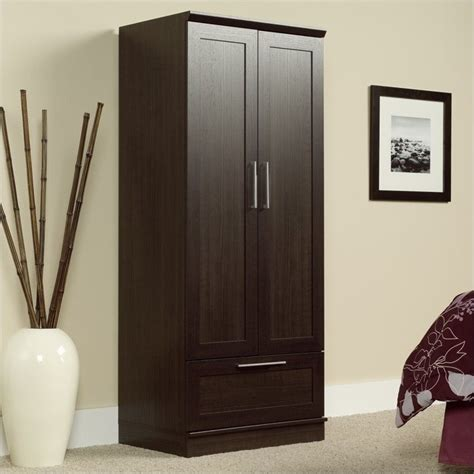 sauder armoire wardrobe homeplus wardrobe armoire in dakota oak finish 411312