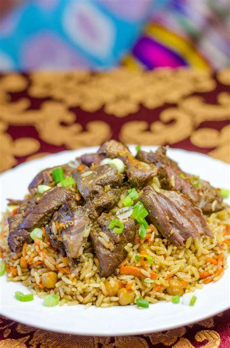 uzbek cuisine foods and drinks uzbek plov or pilaf the hot made with chunks of lamb
