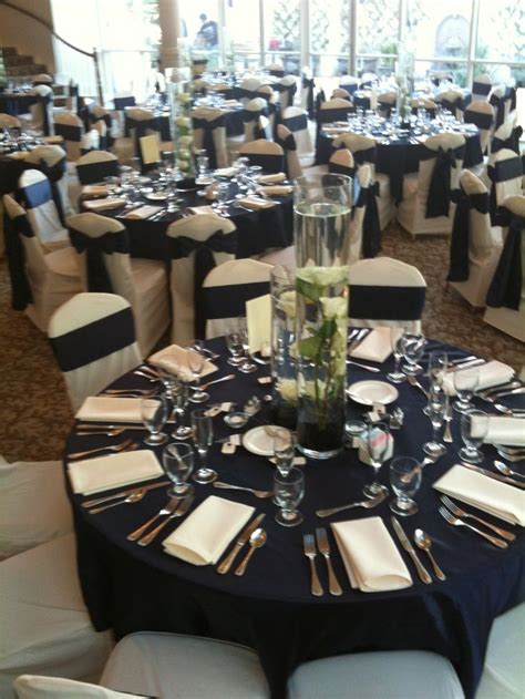 Navy Chair Covers Wedding by Our Ivory Tablecloth Our Satin Navy Overlays With Ivory Chair Covers And Satin Navy Chair