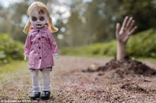 The end a zombie doll walks away from the shallow grave in which she