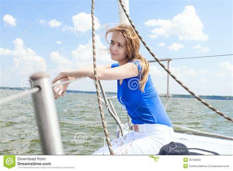 Sailboat Handrails Woman Sitting On Sailboat In Water Horizontal Stock