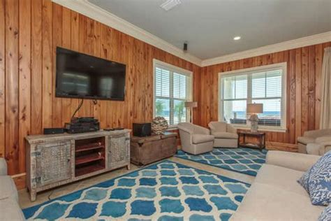 knotty pine walls with white trim to ceiling basement moldings wood trim and