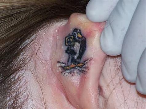 small bird tattoos behind ear bird ear