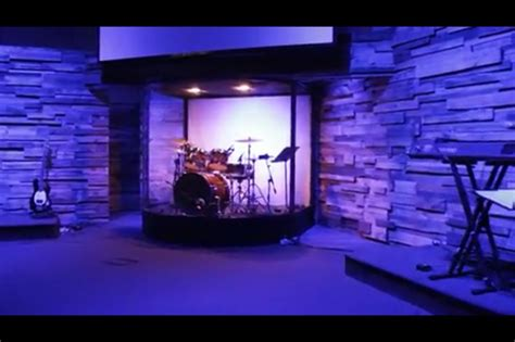DIY curved drum enclosure built using an aluminum frame