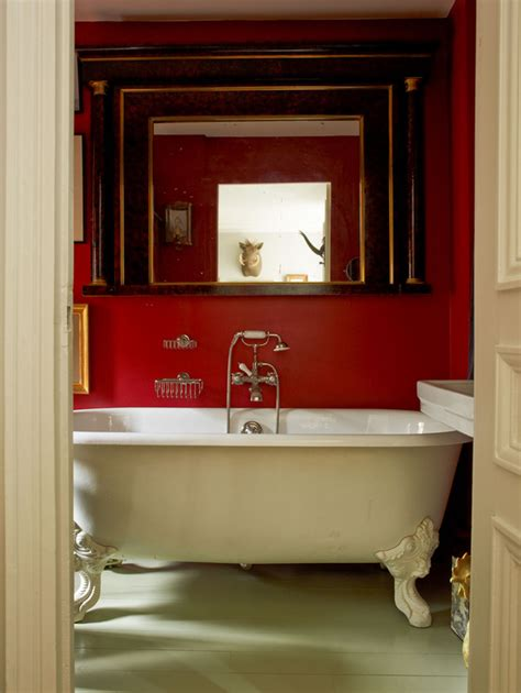 red wall bathroom white tub red walls interiors by color