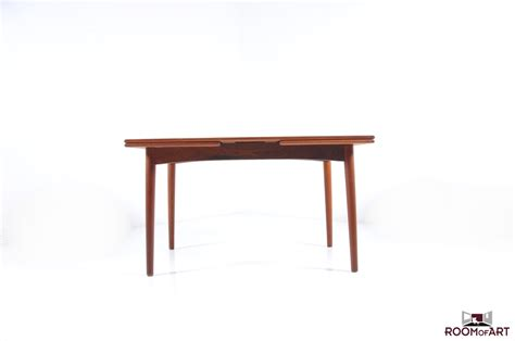 vintage dining table in teak room of
