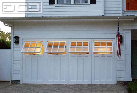 convert garrage door to windows swing open carriage garage door conversion with functional awning windows by dynamic garage door