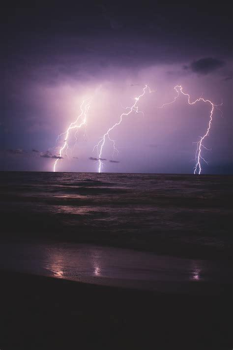 lightning sea horizon night overcast high quality