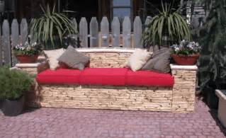make your own outdoor sofa by stacking stones and using