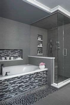 sliced charcoal black pebble tile master bathroom shower