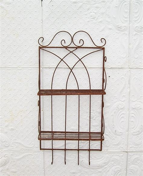 wrought iron 2 tier shelf for books and recipes