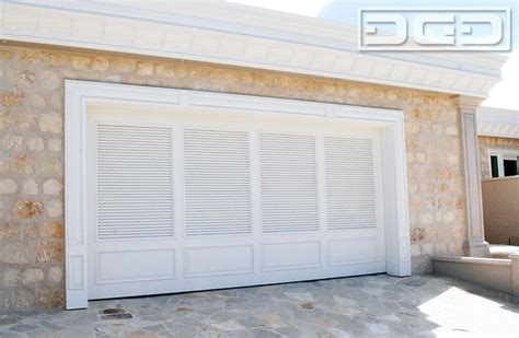 louvered garage doors shutter style garage doors with a louvered design and