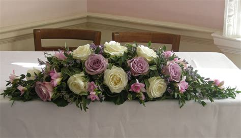 flowers on table ceremony table flower arrangement of ivory avalanch roses