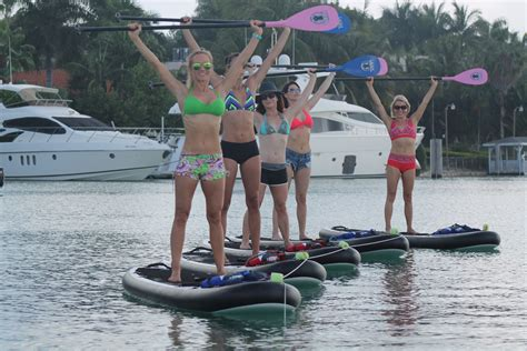 paddle boat yoga fitness yoga paddle the new miami trend