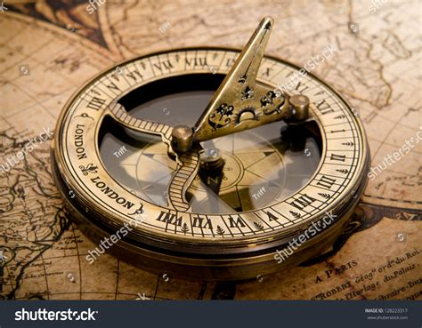 old compass on vintage map 1752 stock photo 128223317