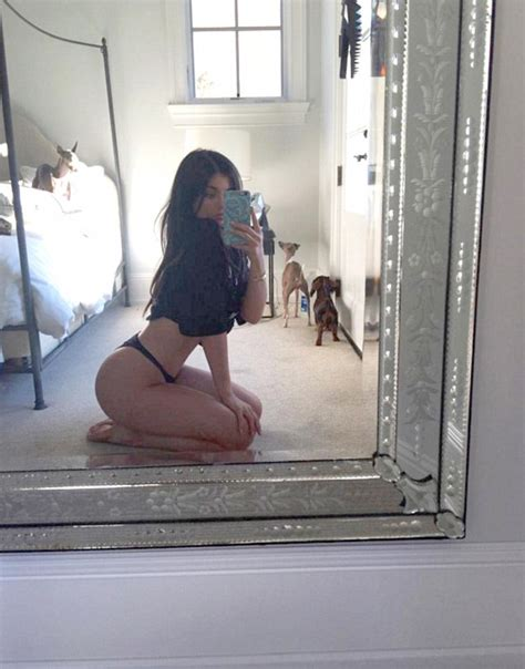 butt naked on the bathroom floor kylie jenner shows off her bum before suffering spillage