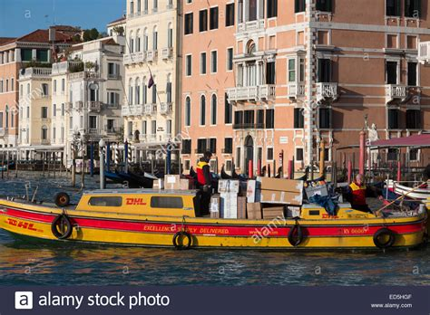 boat lettering venice dhl courier boat delivering packages grand canal venice