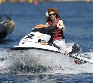 red headed girl water skier ornament nicola accessorises lifejacket with a floral hair clip as she jetskis after tamara