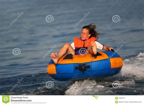 disco tube behind boat feeling centrifugal force stock images image 4053314