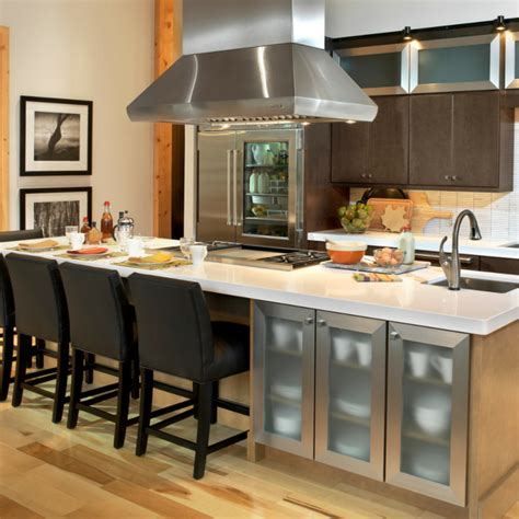 kitchen island with cooktop and seating islands the heart of the kitchen wellborn cabinet blog