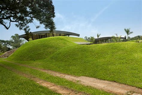grass mounds two homes in luque paraguay by bauen