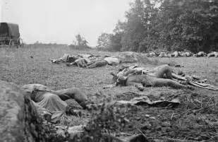 Confederate dead gathered for burial at the edge of the rose woods
